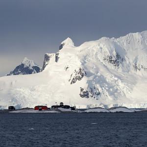 Village along the snowy, rocky coast