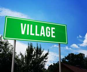 Village On Road Sign