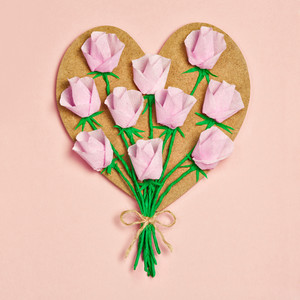 Vintage handmade wooden heart decorated with paper roses