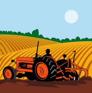 Vintage Tractor With Farmer Driving