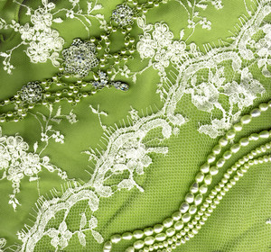 Vintage Wedding Dress Lace On Green Background Texture