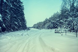 Vintage winter snowy deserted road