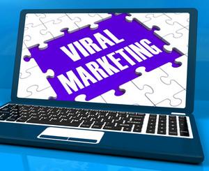 Viral Marketing On Laptop Shows Social Media Advertisement