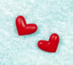Red hearts on the ice