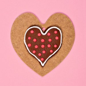 Heart shaped cookies on wooden heart