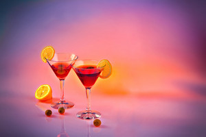 Two martinis on pink background