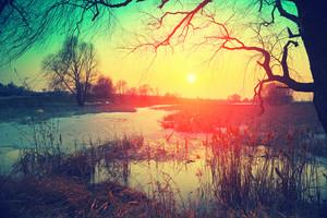 Rural landscape. Sunset over lake