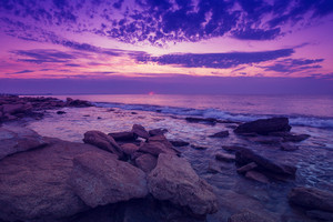Wild rocky beach at dawn