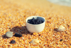 Dead Sea mud in a cup on the seashore