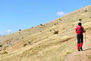 Walking in mountains hiking woman