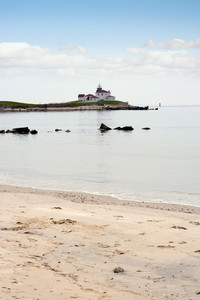 Watch Hill Rhode Island beach with the historic lighthouse landmark in the distance.