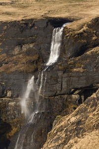 Waterfall flowing down a rocky cliff