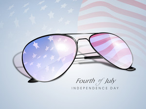 Waving American Flag Reflecting In A Sun Glasses