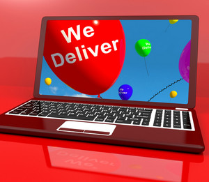 We Deliver Balloons On Computer Showing Delivery Shipping Service Or Logistics
