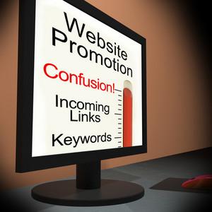 Website Promotion On Monitor Showing Online Marketing