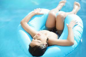Wet kid having happy time on summer swimming pool