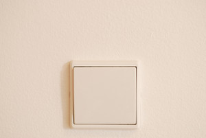 White And Modern Light Switch On Wall