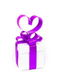 White boxes with purple ribbons and decorative heart