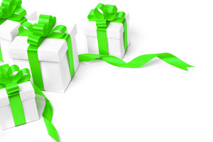 White gift box with green ribbon bow