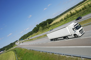 white, large truck on freeway