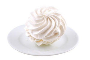 White meringues on white plate isolated on white background