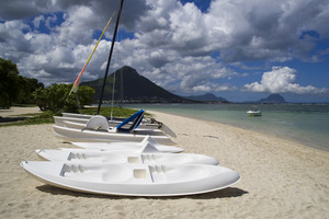 White paddleboats on a tropical beach