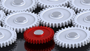 White Steel Gears In Connection With Red One. Concept For Teamwork And Business.
