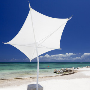 White umbrella on a tropical beach