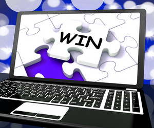 Win Puzzle On Laptop Shows Victory