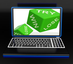 Win, Try, Lose Dices On Laptop Shows Gambling