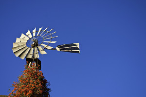Wind Mill Against A Blue Sky