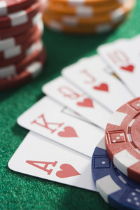 Winning hand of cards on green baize background