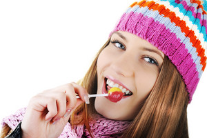 Winter Beautiful Girl licking candy