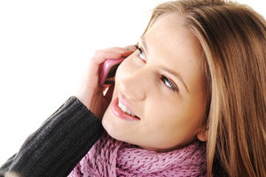 Winter Beautiful Girl speaking on cell phone