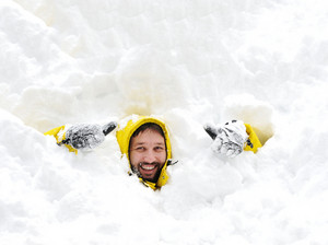 Winter fun adult man playing having a fun in snow