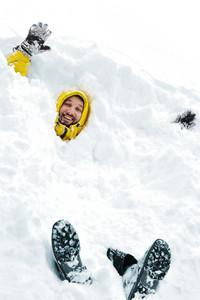 Winter fun adult man playing having a fun in snow