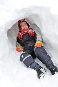 Winter fun kid playing having a fun in snow