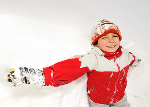 Winter fun kid playing having a fun in snow