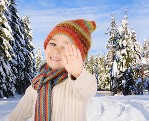 Winter happiness, kid saying stop in snow