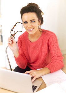 Woman at home with laptop enjoying her job as a freelancer