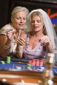 Woman celebrating bridal shower in casino