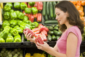 Woman choosing fresh produce in supermarket