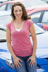 Woman choosing new car from lot