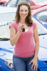 Woman collecting new car from lot