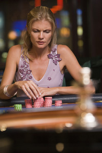 Woman concentrating at roulette table in casino