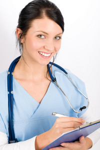 Woman doctor young medical nurse smiling brunette with stethoscope