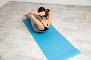 Woman doing strength exercises for abdominal muscles
