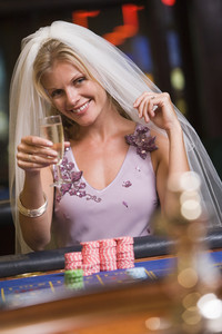 Woman enjoying bridal shower at casino drinking champagne