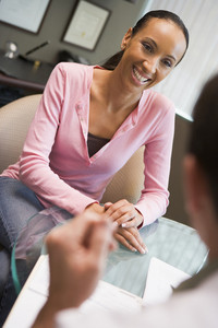 Woman having consultation with doctor in IVF clinic