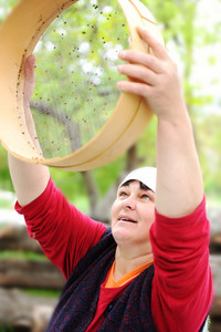 Woman holding a bowl with  a little buckwheat in it